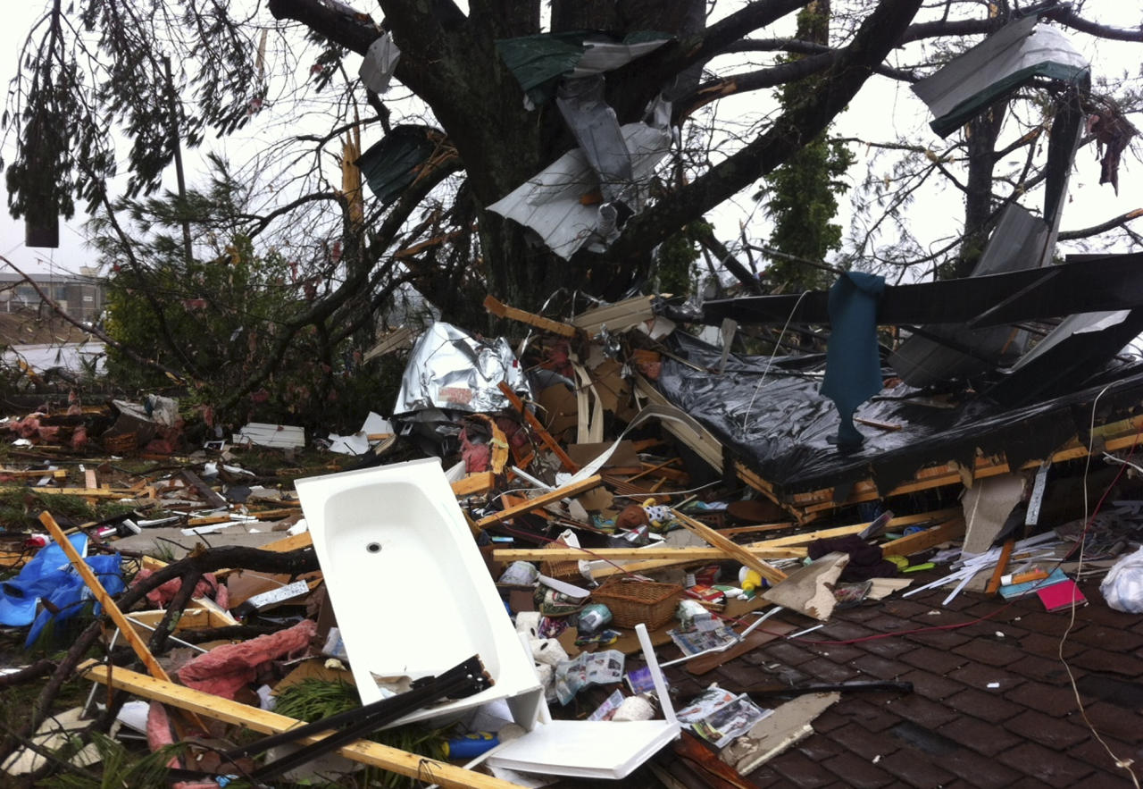 Debris lies on yard after a tornado moved through Adairsville, Ga. Wednesday, Jan. 30, 2013. A fierce storm system that roared across northwest Georgia has left at least one person dead and a trail of damage that included demolished buildings in downtown Adairsville and vehicles overturned on Interstate 75 northwest of Atlanta. A tornado touched down in Adairsville, and authorities confirmed that at least one person was killed in the town about 60 miles northwest of Atlanta. (AP Photo/David Goldman)