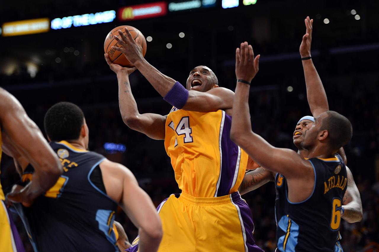 LOS ANGELES, CA - MAY 12:  Kobe Bryant #24 of the Los Angeles Lakers goes up for a shot over Arron Afflalo #6 of the Denver Nuggets in the first half in Game Seven of the Western Conference Quarterfinals in the 2012 NBA Playoffs on May 12, 2012 at Staples Center in Los Angeles, California. NOTE TO USER: User expressly acknowledges and agrees that, by downloading and or using this photograph, User is consenting to the terms and conditions of the Getty Images License Agreement.  (Photo by Harry How/Getty Images)
