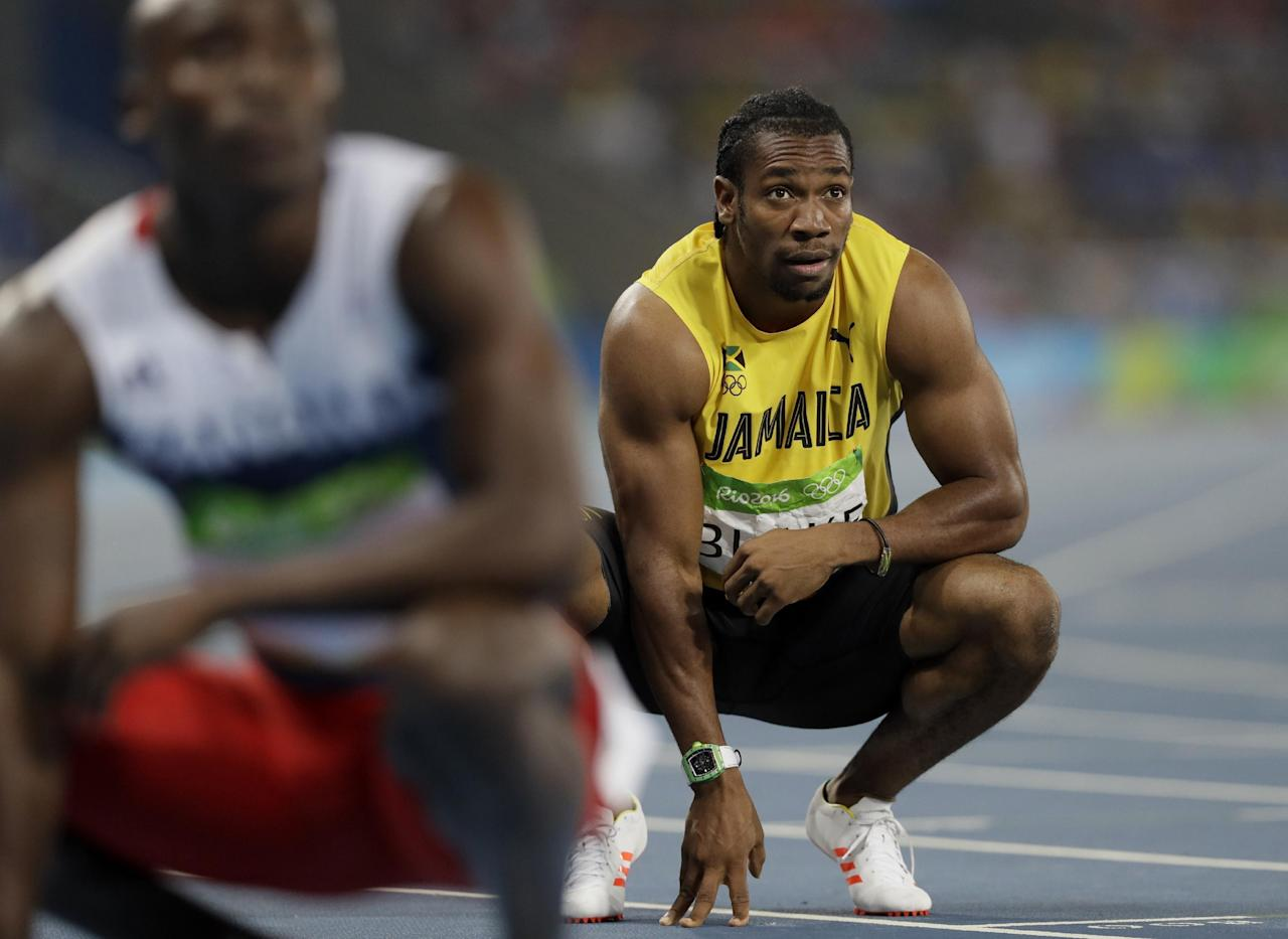 Jamaica's Yohan Blake looks at the scoreboard after in a men's 200-meter semifinal during the athletics competitions of the 2016 Summer Olympics at the Olympic stadium in Rio de Janeiro, Brazil, Wednesday, Aug. 17, 2016. (AP Photo/David J. Phillip)