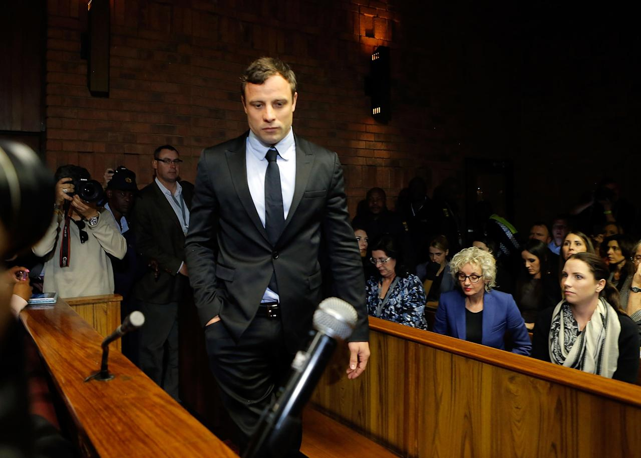 PRETORIA, SOUTH AFRICA - AUGUST 19: South African athlete Oscar Pistorius appears in Pretoria Magistrates Court for an indictment hearing on August 19, 2013 in Pretoria, South Africa. Pistorius, 26 is accused of murdering his girlfriend Reeva Steenkamp which Pistorius denies claiming he mistook Steenkamp for an intruder. The indictment was served and the trial date of March 3, 2014 was set in Pretoria Magistrates Court. (Photo by Jemal Countess/Getty Images)