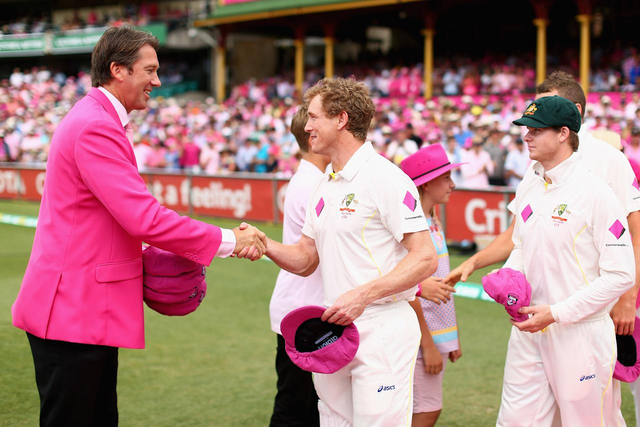SYDNEY, AUSTRALIA - JANUARY 05: George Bailey of Australia presents a pink cap to former Australian cricketer Glenn McGrath on Jane McGrath Day during day three of the Fifth Ashes Test match between Australia and England at Sydney Cricket Ground on January 5, 2014 in Sydney, Australia.  (Photo by Cameron Spencer/Getty Images)