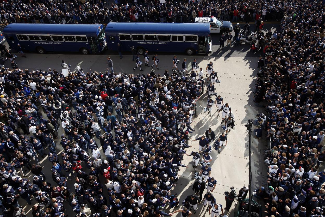 The Penn State team is greated by fans as they arrive before an NCAA college football game agenst Nebraska and Saturday, Nov. 12, 2011, in State College, Pa. (AP Photo/Matt Rourke)