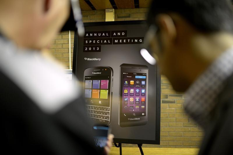 Blackberry users look at new device at the BlackBerry Annual and Special Meeting in Waterloo