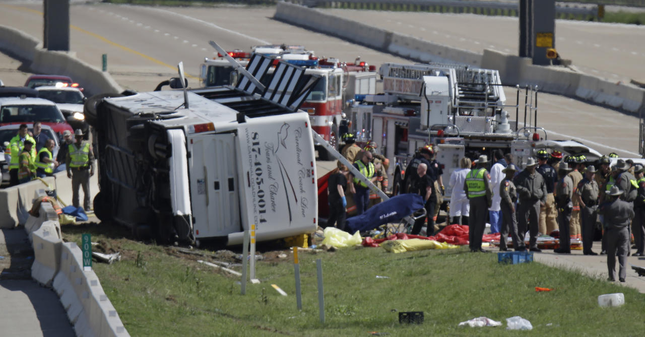 A fatality is rolled away as emergency responders works the scene of bush crash on the George Bush Turnpike Thursday, April 11, 2013, in Irving, Texas. The chartered bus overturned on the busy highway near Dallas on killing at least two people and injuring several others, authorities said. (AP Photo/LM Otero)