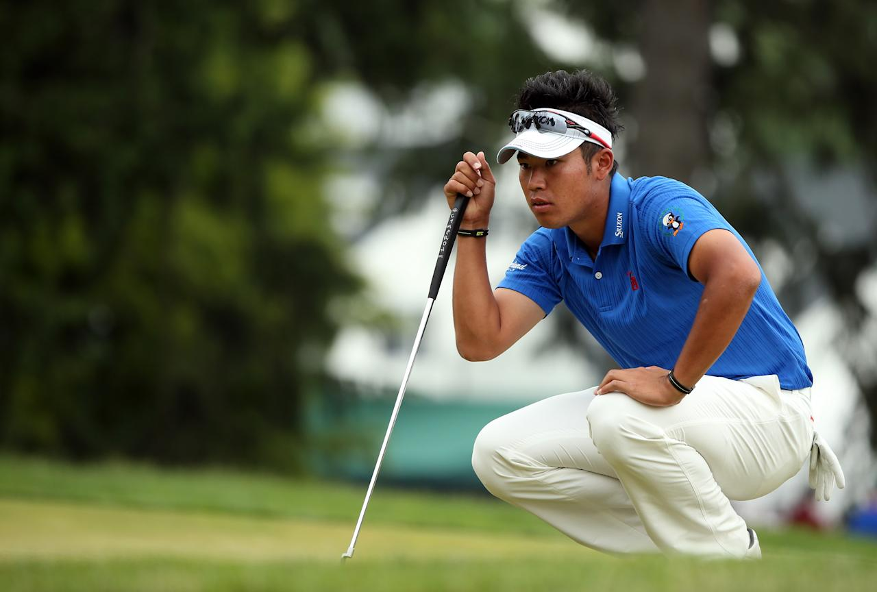 ARDMORE, PA - JUNE 16:  Hideki Matsuyama of Japan lines up his putt on the first hole during the final round of the 113th U.S. Open at Merion Golf Club on June 16, 2013 in Ardmore, Pennsylvania.  (Photo by Andrew Redington/Getty Images)