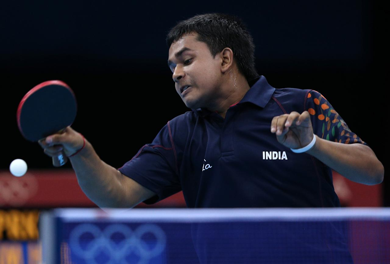 LONDON, ENGLAND - JULY 29:  Soumyajit Ghosh of India plays a forehand in his Men's Singles second round match against Hyok Bong Kim of Korea on Day 2 of the London 2012 Olympic Games at ExCeL on July 29, 2012 in London, England.  (Photo by Feng Li/Getty Images)