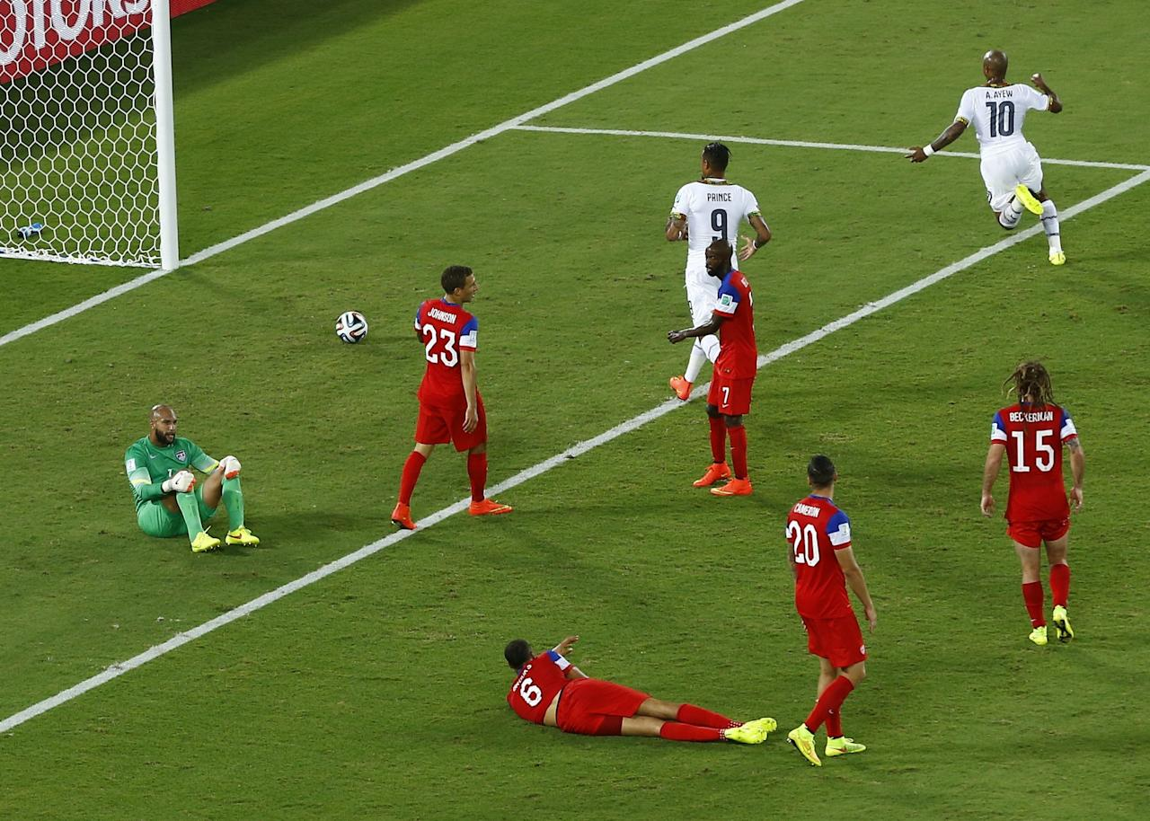 Ghana's Andre Ayew (top R) celebrates after scoring a goal against the U.S. during their 2014 World Cup Group G soccer match at the Dunas arena in Natal June 16, 2014. REUTERS/Carlos Barria (BRAZIL - Tags: SOCCER SPORT WORLD CUP)