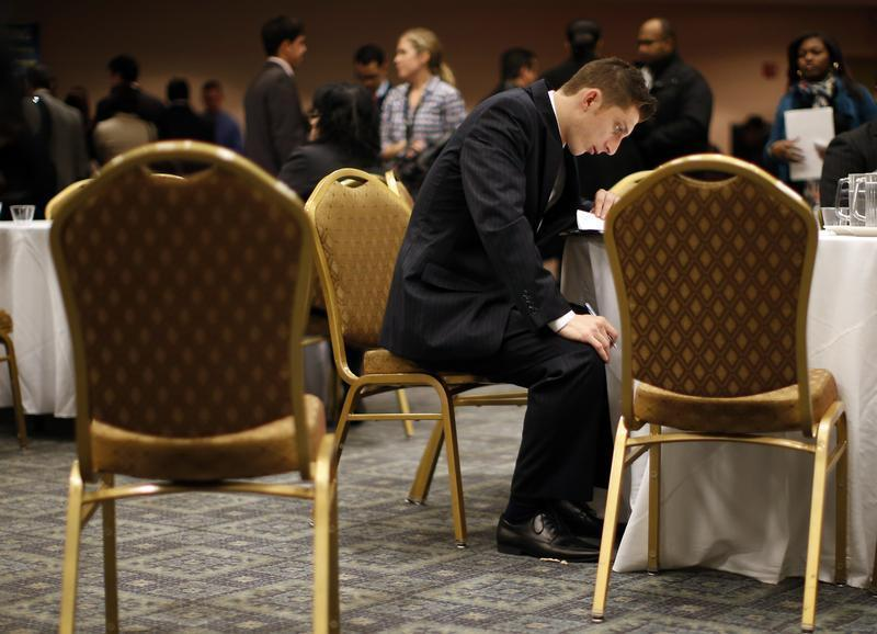 Job seeker fills out forms at career fair in New York City