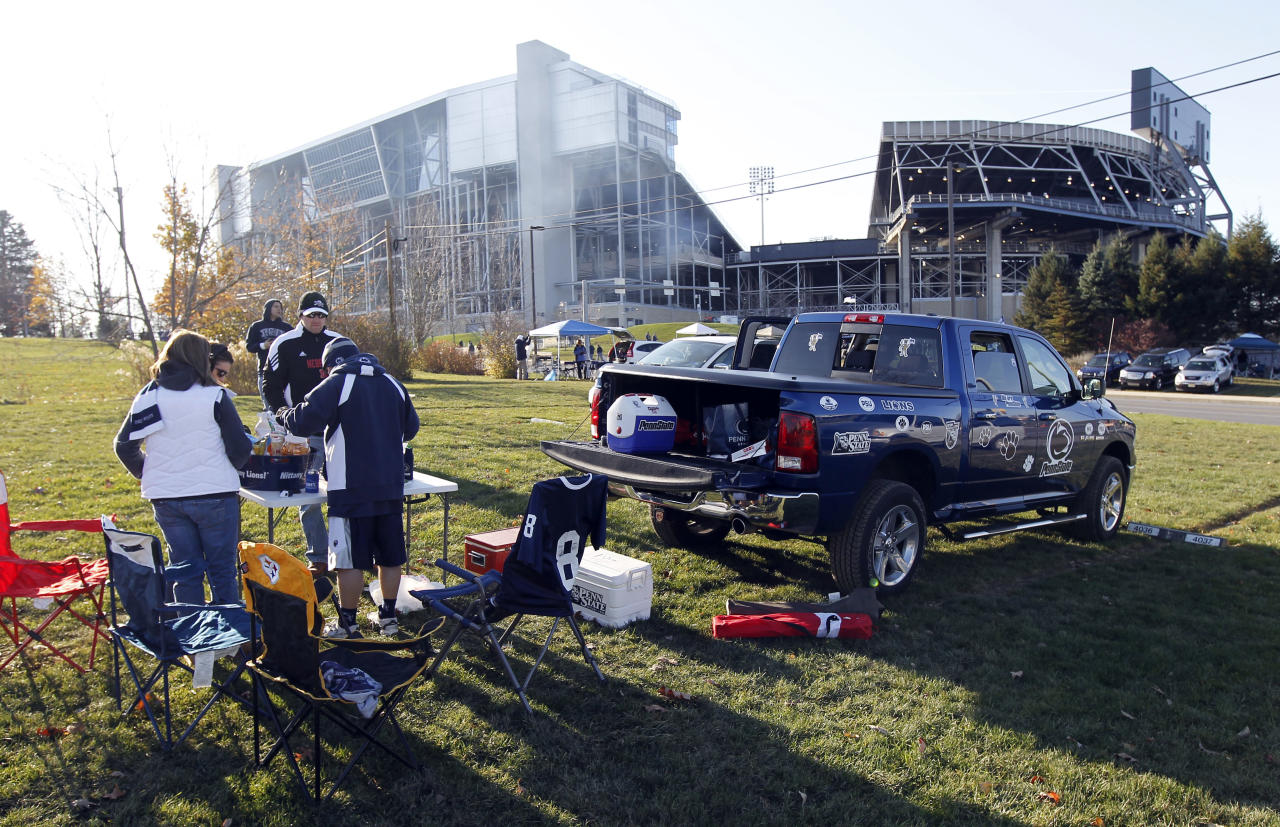 Fans tailgate at Penn State's Beaver Stadium before their game with the University of Nebraska Saturday, Nov. 12, 2011 in State College, Pa. Penn State is playing for the first time in decades without former head coach Joe Paterno, after he was fired in the wake of a child sex abuse scandal involving a former assistant coach. (AP Photo/Alex Brandon)