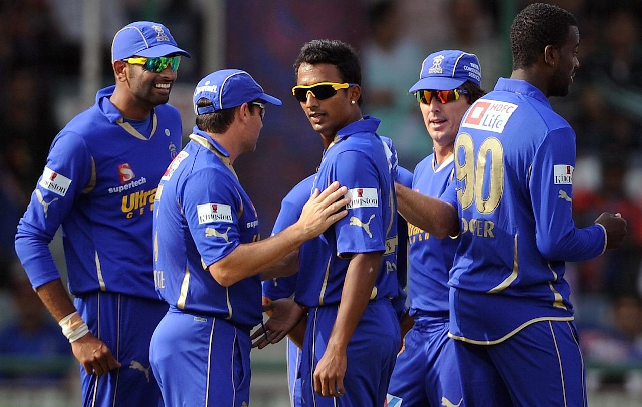 Rajasthan Royals Bowler Ankeet Chavan (C) celebrates the wicket of Delhi Daredevils batsman Kevin Pieterson (unseen) with teammates during the IPL Twenty20 cricket match between Delhi Daredevils and Rajasthan Royals at the Feroz Shah Kotla Stadium in New Delhi on April 29, 2012.  RESTRICTED TO EDITORIAL USE. MOBILE USE WITHIN NEWS PACKAGE.    AFP PHOTO/Prakash SINGH        (Photo credit should read PRAKASH SINGH/AFP/GettyImages)
