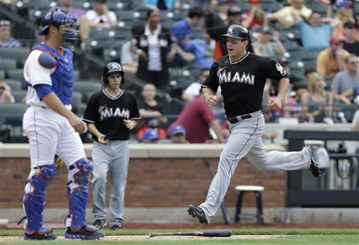 Extras again: Marlins beat Mets 8-4 in 10 innings