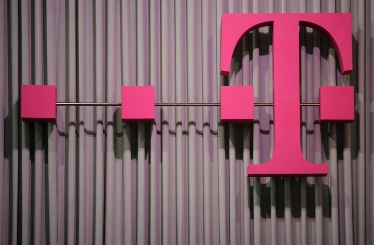 File photo of the logo of German company Deutsche Telekom at the CeBit computer fair in Hanover