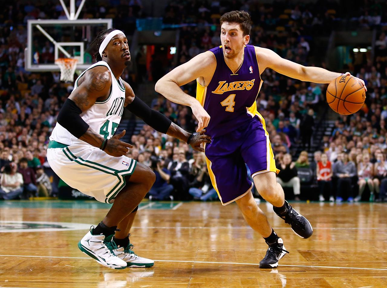 BOSTON, MA - JANUARY 17: Ryan Kelly #4 of the Los Angeles Lakers drives to the basket past Gerald Wallace #45 of the Boston Celtics in the second half during the game at TD Garden on January 17, 2014 in Boston, Massachusetts. NOTE TO USER: User expressly acknowledges and agrees that, by downloading and or using this photograph, User is consenting to the terms and conditions of the Getty Images License Agreement. (Photo by Jared Wickerham/Getty Images)