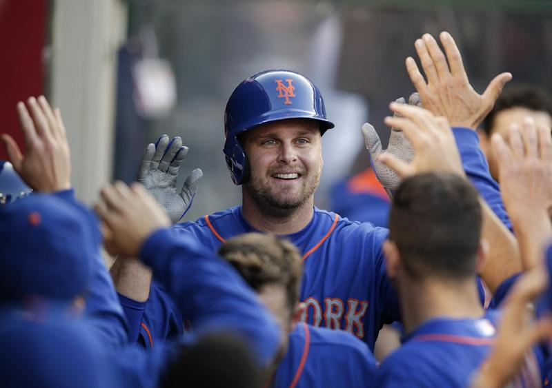 New York Mets' Lucas Duda, center, celebrates his home run with teammates during the second inning of a baseball game against the Los Angeles Angels on Saturday, April 12, 2014, in Anaheim, Calif