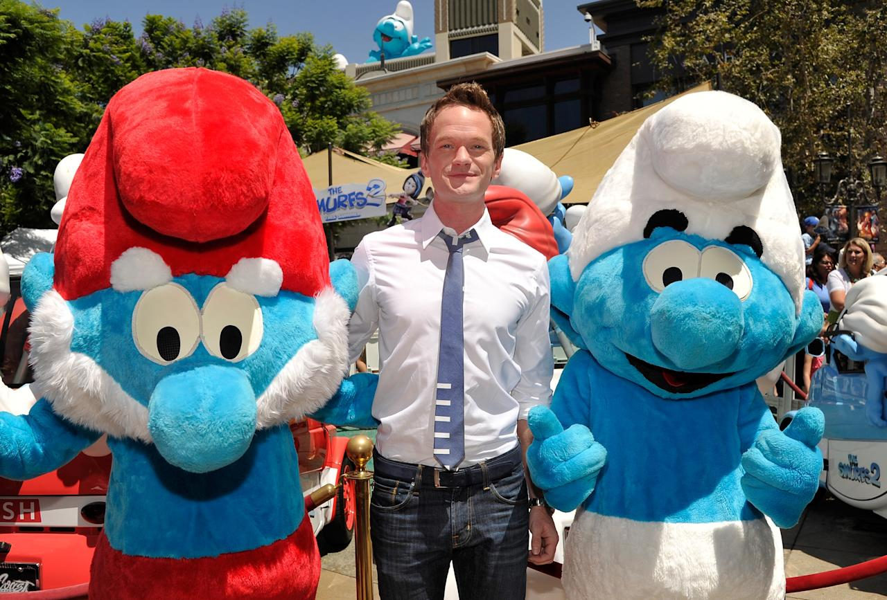 LOS ANGELES, CA - JUNE 22: Actor Neil Patrick Harris (C) with Papa Smurf and Clumsy Smurf attend the Global Smurfs Day celebration in Los Angeles on June 22, 2013 in Los Angeles, California. (Photo by John Sciulli/Getty Images for Sony Pictures Entertainment)
