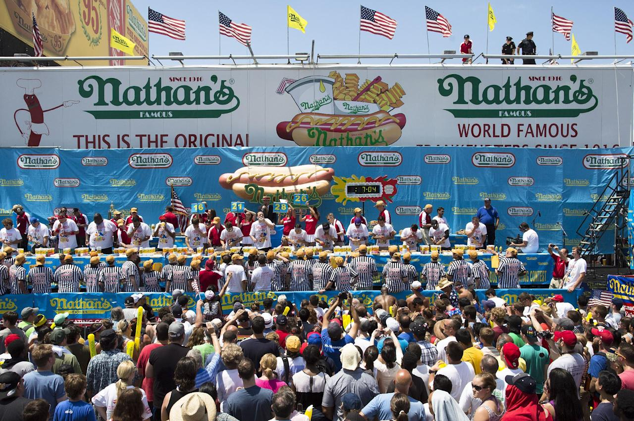 The Nathan's Famous Fourth of July International Hot Dog Eating contest men's competition kicks off in front of crowds of fans at Coney Island, Thursday, July 4, 2013 at Coney Island, in the Brooklyn borough of New York. (AP Photo/John Minchillo)