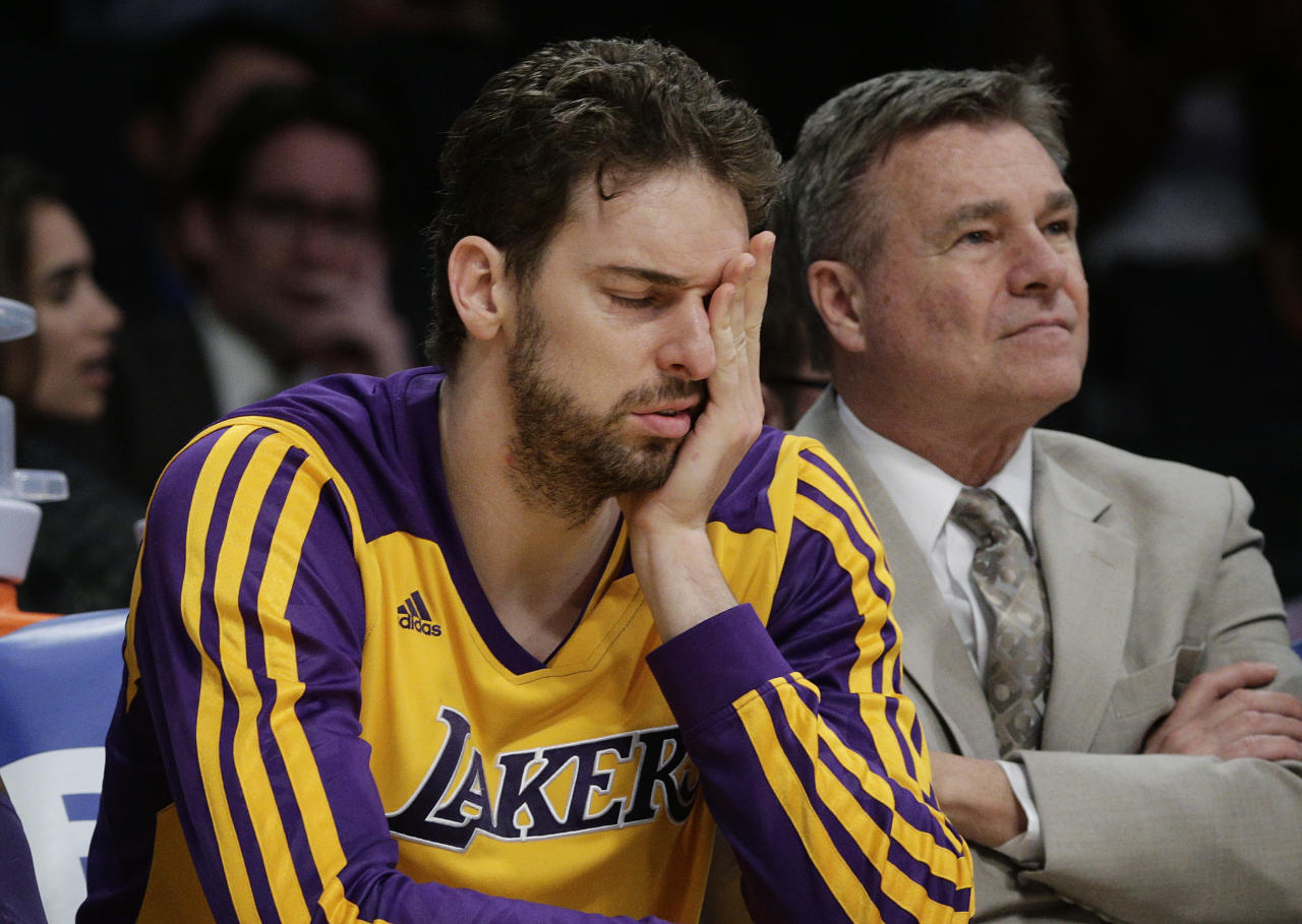 Los Angeles Lakers' Pau Gasol, of Spain, covers his face while sitting on the bench during the second half of an NBA basketball game against the Los Angeles Clippers on Thursday, March 6, 2014, in Los Angeles. The Clippers won 142-94. (AP Photo/Jae C. Hong)