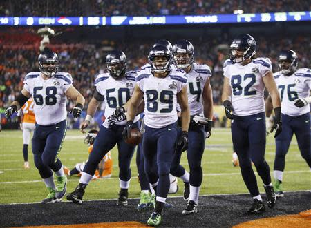 Seattle Seahawks wide receiver Baldwin celebrates his touchdown against the Denver Broncos with teammates during the fourth quarter in NFL Super Bowl XLVIII in East Rutherford