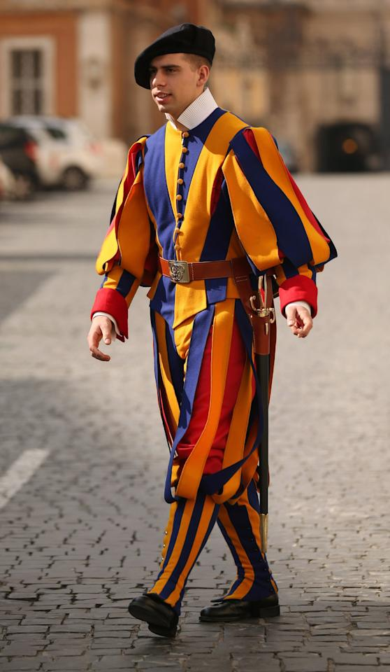 VATICAN CITY, VATICAN - FEBRUARY 26:  A member of the Swiss Guard stands at a vehicle entrance at the edge of Saint Peter's Square ahead of Pope Benedict XVI's last public audience on February 26, 2013 in Vatican City, Vatican. The Pontiff will hold his last weekly public audience on February 27, 2013 before he retires the following day. Pope Benedict XVI has been the leader of the Catholic Church for eight years and is the first Pope to retire since 1415. He cites ailing health as his reason for retirement and will spend the rest of his life in solitude away from public engagements.  (Photo by Oli Scarff/Getty Images)