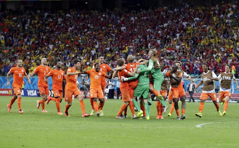 The Dutch team celebrates after the Netherlands defeated Costa Rica 4-3 in a penalty shootout after a 0-0 tie during the World Cup quarterfinal soccer match at the Arena Fonte Nova in Salvador, Brazil, Saturday, July 5, 2014