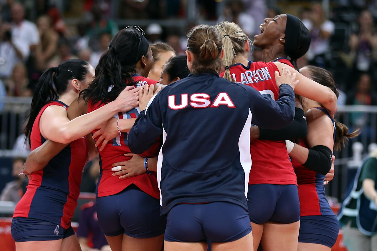 LONDON, ENGLAND - AUGUST 09:  Team United States celebrates after defeating Korea during the Women's Volleyball semifinal match on Day 13 of the London 2012 Olympics Games at Earls Court on August 9, 2012 in London, England.  (Photo by Elsa/Getty Images)
