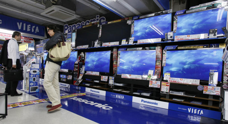 Japan approves new stimulus for ailing economy