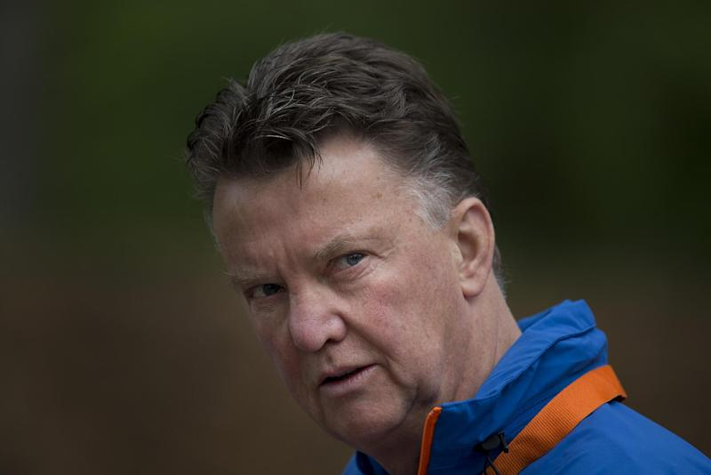 In this Thursday, May 15, 2014 file photo, Louis Can Gaal, coach of the Dutch national soccer team walks towards the mixed zone after a team training in Hoenderloo, eastern Netherlands. Manchester United has hired Netherlands coach Louis Van Gaal as the club's new manager it was announced on Monday, May 19, 2014. Van Gaal, who will leave his position with the Dutch after the upcoming World Cup in Brazil, replaces David Moyes following his firing last month after just 10 months in charge