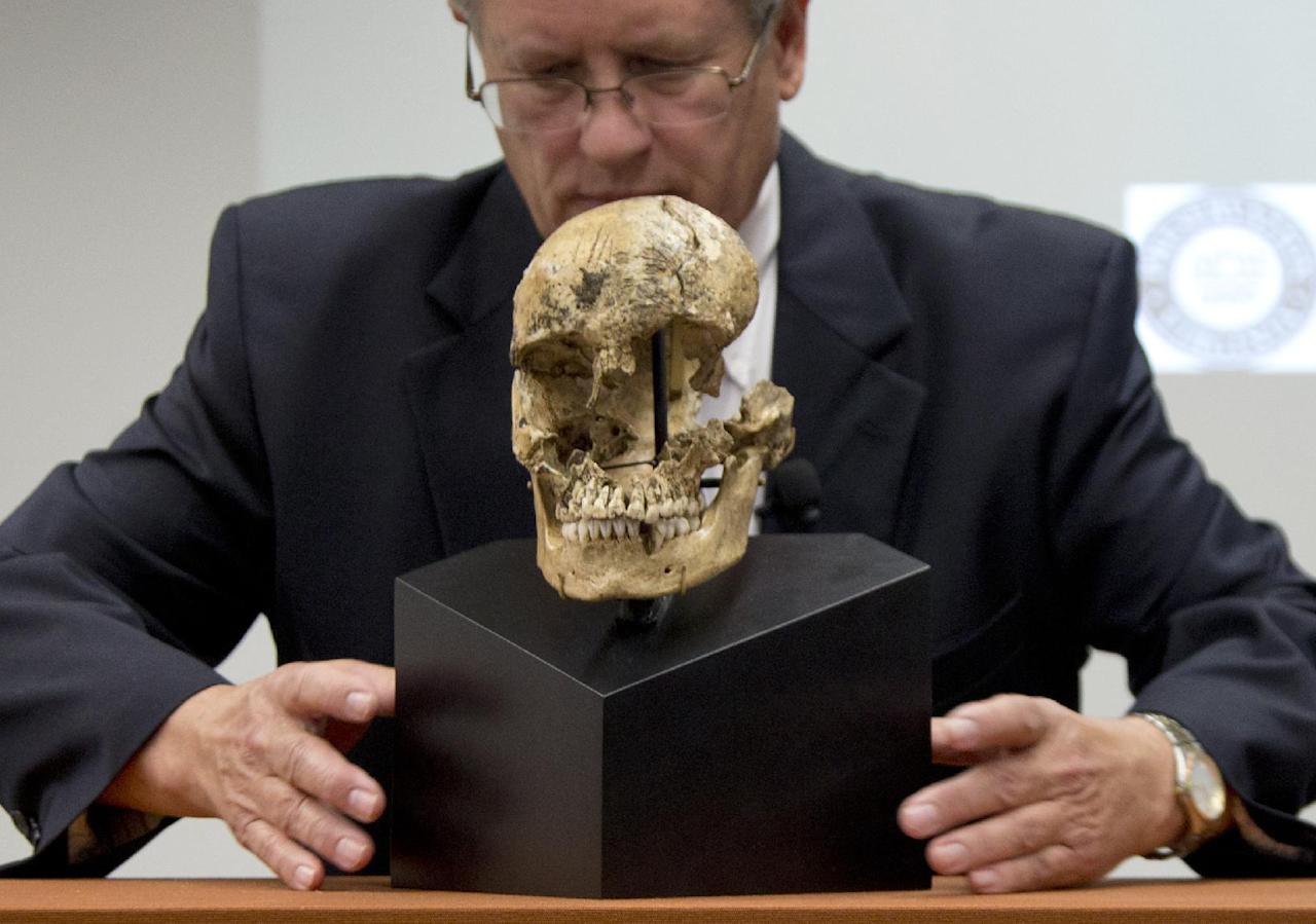 """Doug Owsley, division head for Physical Anthropology at the Smithsonian's National Museum of Natural History, displays the skull of """"Jane of Jamestown"""" during a news conference at the museum in Washington, Wednesday, May 1, 2013. Scientists announced during the news conference that they have found the first solid archaeological evidence that some of the earliest American colonists at Jamestown, Va., survived harsh conditions by turning to cannibalism presenting the discovery of the bones of a 14-year-old girl, """"Jane"""" that show clear signs that she was cannibalized. (AP Photo/Carolyn Kaster)"""