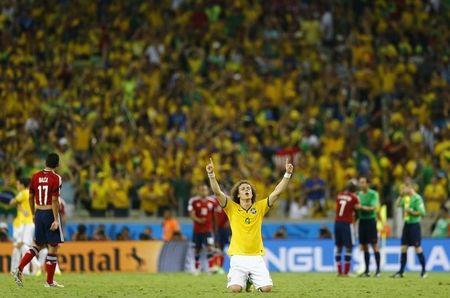 Brazil's David Luiz celebrates at the end of the 2014 World Cup quarter-finals between Brazil and Colombia at the Castelao arena