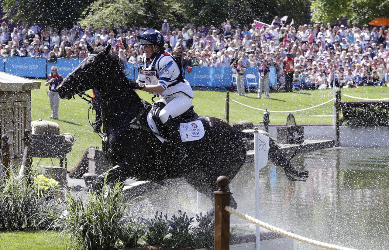 Britain's Nicola Wilson competes with her horse, Opposition Buzz, in the equestrian eventing cross country phase at Greenwich Park, at the 2012 Summer Olympics, Monday, July 30, 2012, in London. (AP Photo/Markus Schreiber)