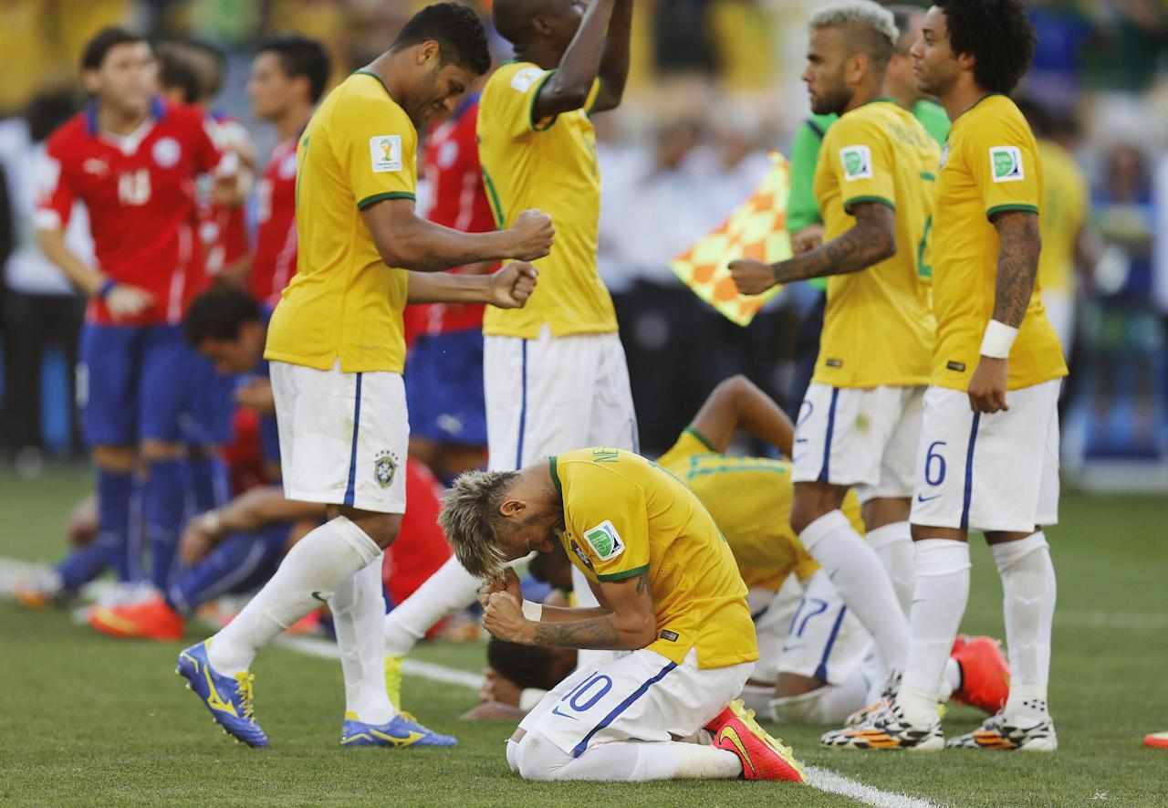 Brazil's Neymar reacts during the penalty shoot-out during the World Cup round of 16 soccer match between Brazil and Chile at the Mineirao Stadium in Belo Horizonte, Brazil, Saturday, June 28, 2014. Brazil won 3-2 on penalties. (AP Photo/Frank Augstein)