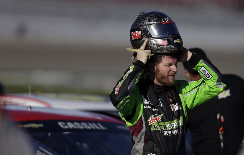 Dale Earnhardt Jr. puts on his helmet during qualifying for Sunday's NASCAR Sprint Cup Series auto race on Friday, March 7, 2014, in Las Vegas