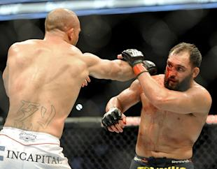 Johny Hendricks [R] considered pulling out of his UFC 171 fight against Robbie Lawler. (AP)