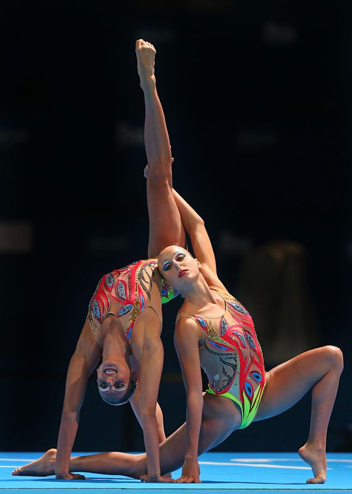 BARCELONA, SPAIN - JULY 21: Linda Cerruti and Francesca Deidda of Italy compete in the Synchronized Swimming Free Combination final on day two of the 15th FINA World Championships at Palau Sant Jordi on July 21, 2013 in Barcelona, Spain. (Photo by Alexander Hassenstein/Getty Images)