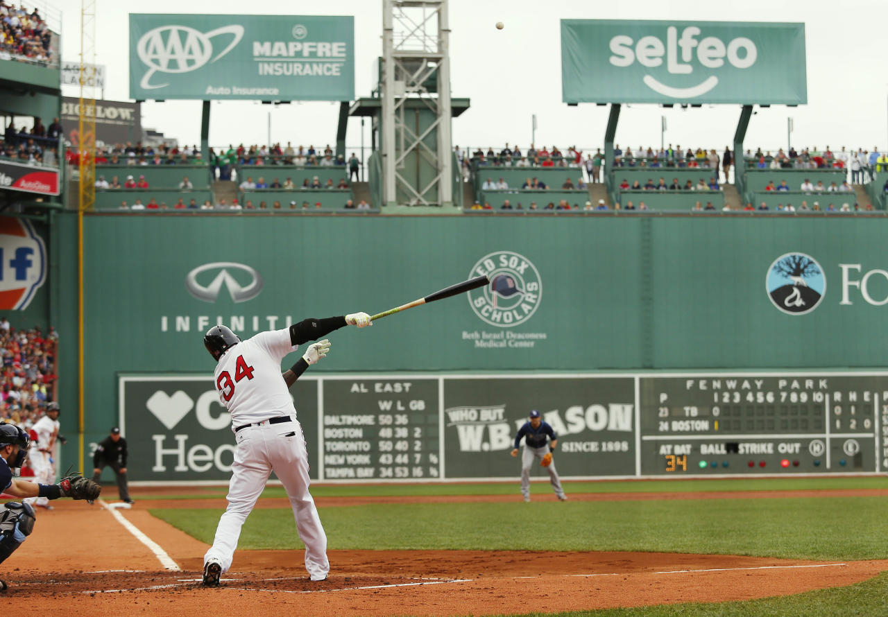 Boston Red Sox designated hitter David Ortiz hits an opposite field two-run home run against the Tampa Bay Rays during the first inning of a baseball game at Fenway Park in Boston Sunday, July 10, 2016. (AP Photo/Winslow Townson)