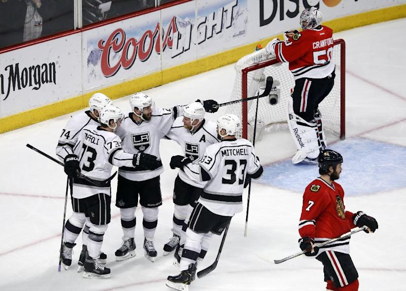Los Angeles Kings center Tyler Toffoli (73) celebrates his goal with his teammates during the second period in Game 7 of the Western Conference finals against the Chicago Blackhawks in the NHL hockey Stanley Cup playoffs Sunday, June 1, 2014, in Chicago