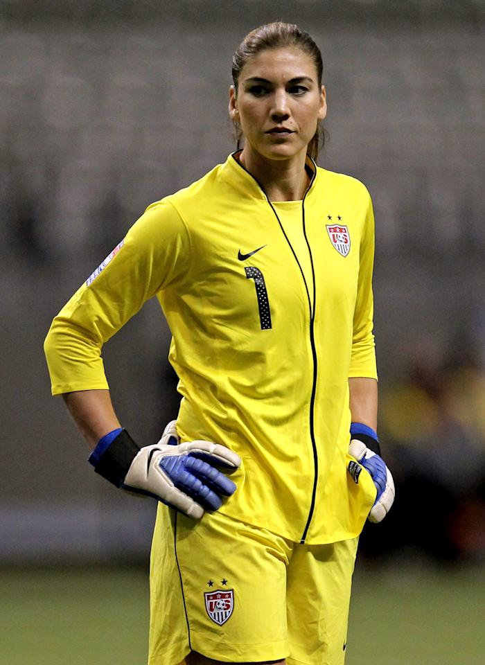 United States goalkeeper Hope Solo (1) reacts during the first half of a CONCACAF women's Olympic qualifying soccer match against the Dominican Republic in Vancouver, British Columbia, Friday, Jan. 20, 2012. (AP Photo/The Canadian Press, Jonathan Hayward)