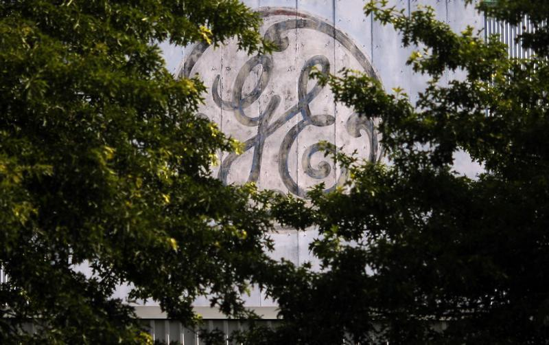 A faded, painted logo sits over the entrance to a General Electric Co. facility in Medford