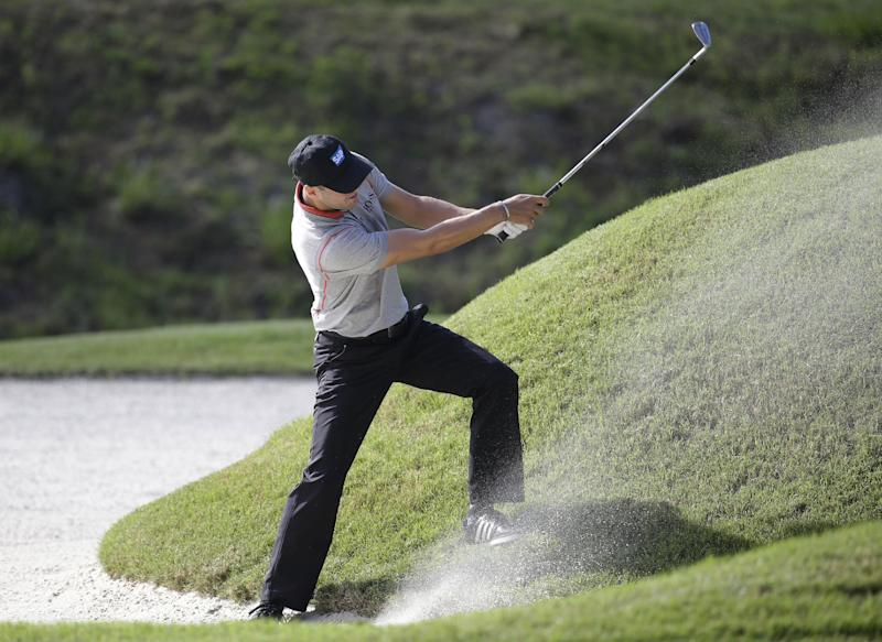 Kaymer leads Spieth by 1 at Players Championship