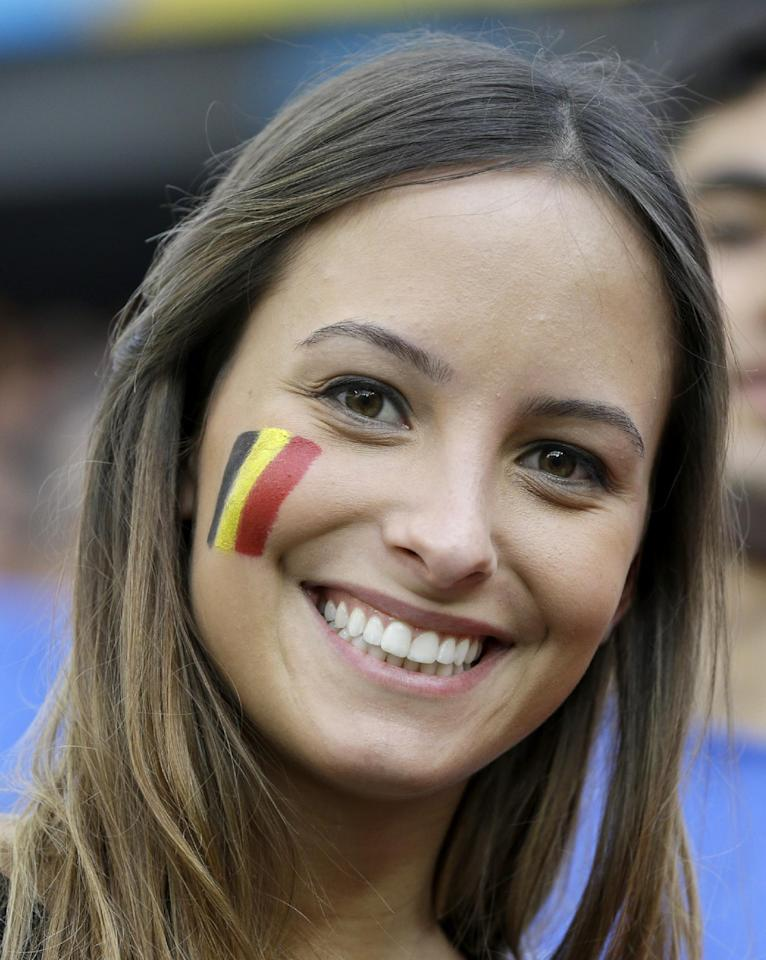 A Belgian fan shows off her national team's colors on her cheek before the group H World Cup soccer match between South Korea and Belgium at the Itaquerao Stadium in Sao Paulo, Brazil, Thursday, June 26, 2014. (AP Photo/Thanassis Stavrakis)