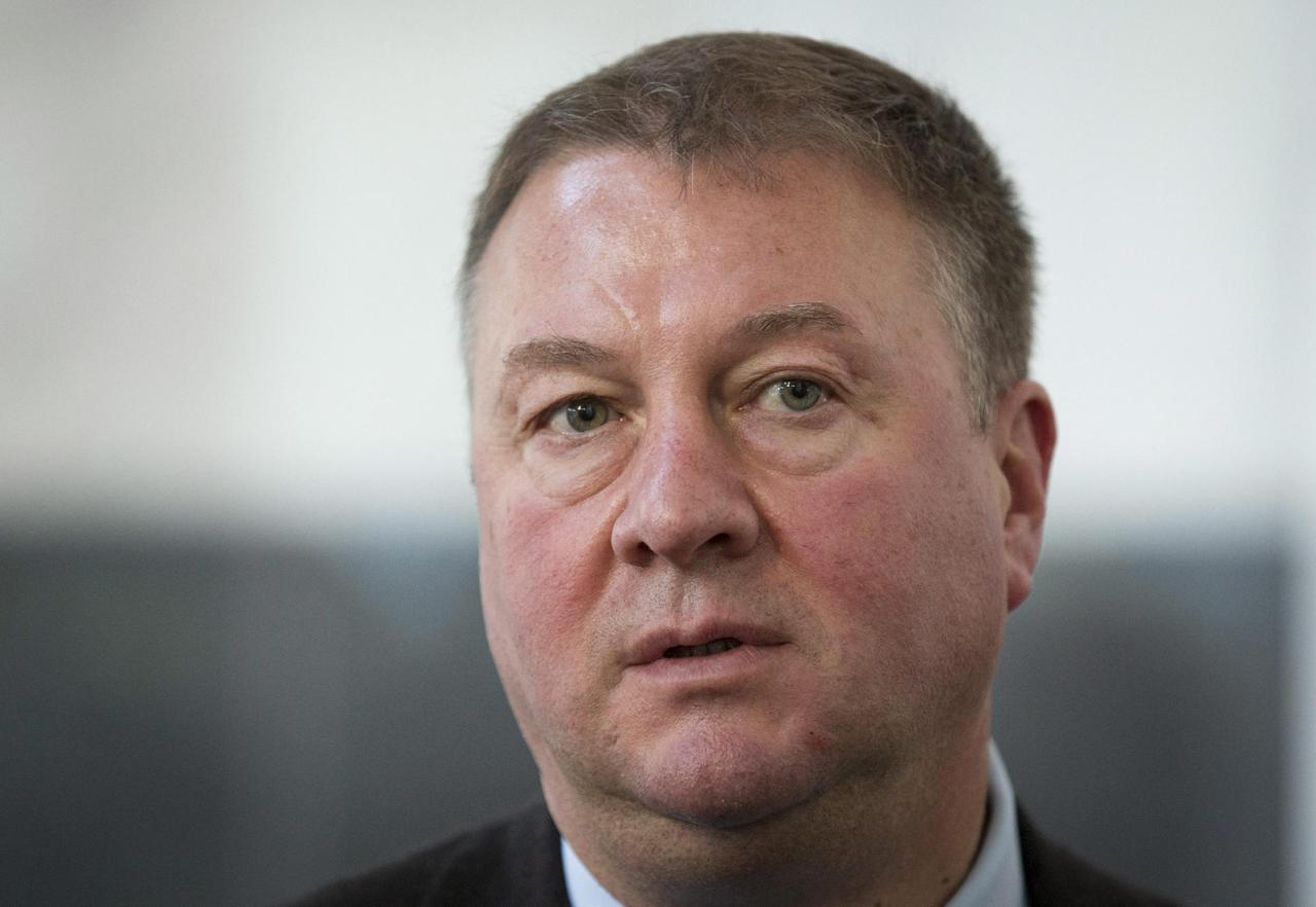 Vancouver Canucks general manager Mike Gillis speaks to reporters following the NHL general managers' meetings in Toronto, Tuesday, Nov. 12, 2013. (AP Photo/The Canadian Press, Mark Blinch)