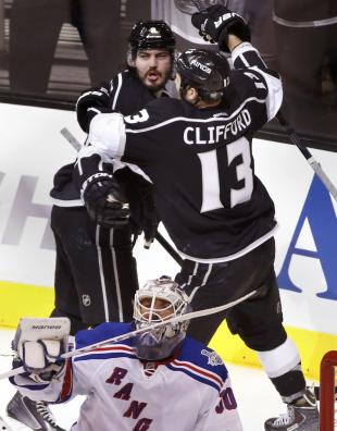 Doughty celebrates his goal on Rangers goalie Henrik Lundqvist with teammate Kyle Clifford during Game 1 of Stanley Cup Final in Los Angeles. (Reuters)