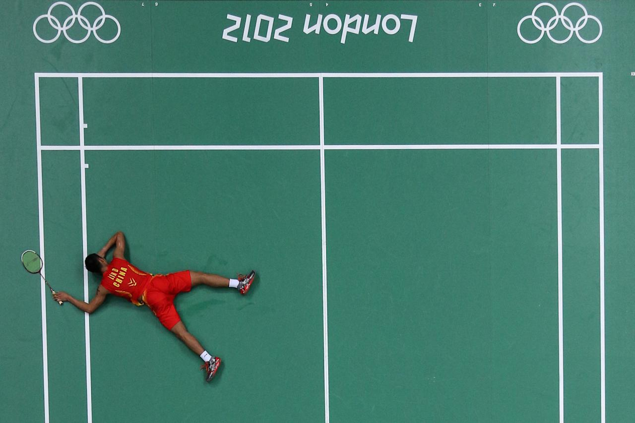 LONDON, ENGLAND - AUGUST 02: Dan Lin of China celebrates after defeating Sho Sasaki of Japan in their Men's Singles Badminton quarter final on day 6 of the London 2012 Olympic Games at Wembley Arena on August 2, 2012 in London, England.  (Photo by Chris McGrath/Getty Images)