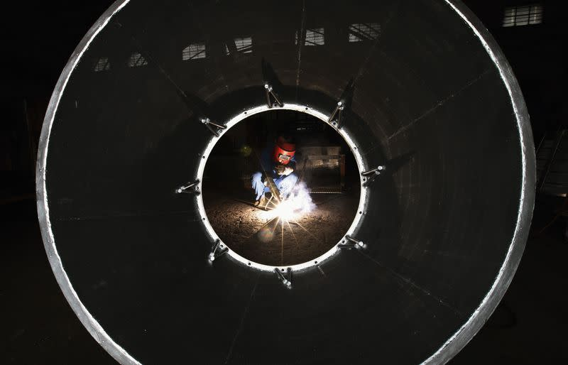An employee works at a machine manufacturing factory in Huaibei