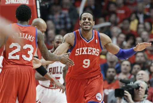 Philadelphia 76ers forward Andre Iguodala (9) smiles as he celebrates with guard Louis Williams (23) after his dunk against the Chicago Bulls during the third quarter of Game 2 in an NBA basketball first-round playoff series, in Chicago on Tuesday, May 1, 2012. (AP Photo/Nam Y. Huh)