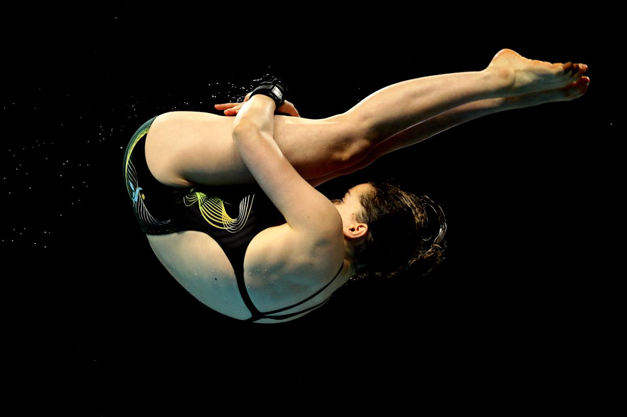 DELHI, INDIA - OCTOBER 11:  Annabelle Smith of Australia competes in the Women's 10m Platform Final at Dr. S.P. Mukherjee Aquatics Complex during day eight of the Delhi 2010 Commonwealth Games on October 11, 2010 in Delhi, India.  (Photo by Matt King/Getty Images)