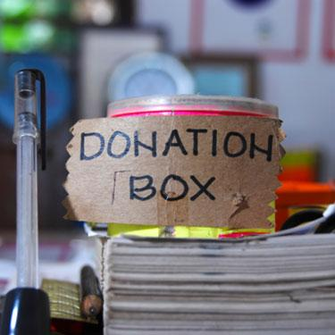 Donation-box-on-stack-of-papers_web