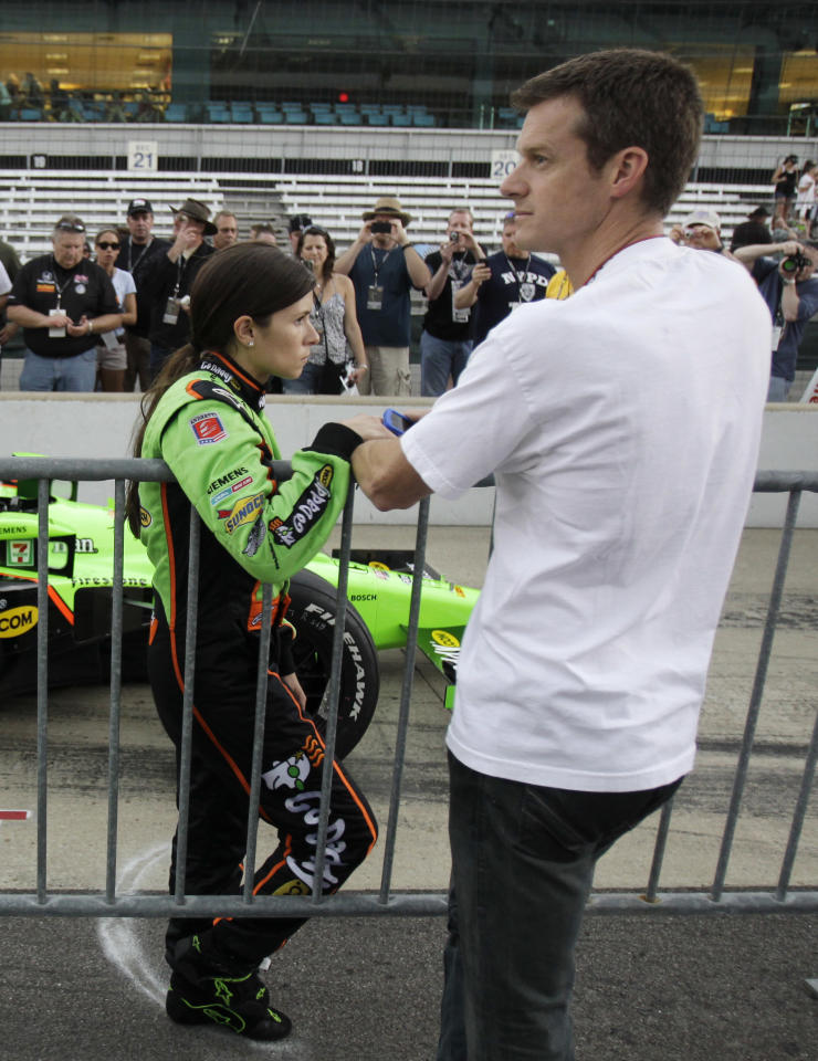 IndyCar driver Danica Patrick, left, and her husband Paul Hospenthal wait for her turn to qualify on the final day of qualifications for the Indianapolis 500 auto racing at the Indianapolis Motor Speedway in Indianapolis, Sunday, May 22, 2011.