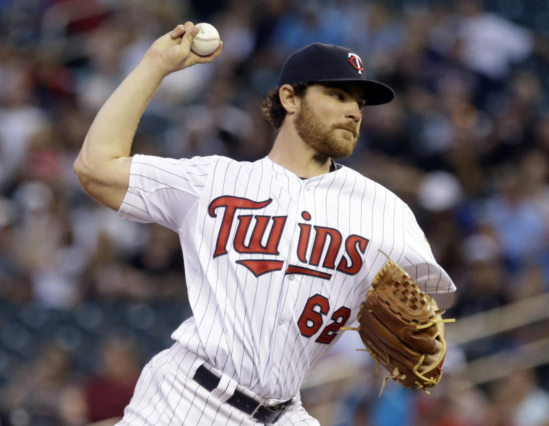 Willingham homers twice and Twins beat A's 4-3