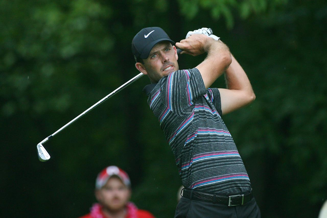 GREENSBORO, NC - AUGUST 19: Charl Schwartzel of South Africa hits his tee shot on the second hole during the final round of the Wyndham Championship at Sedgefield Country Club on August 19, 2012 in Greensboro, North Carolina. (Photo by Hunter Martin/Getty Images)